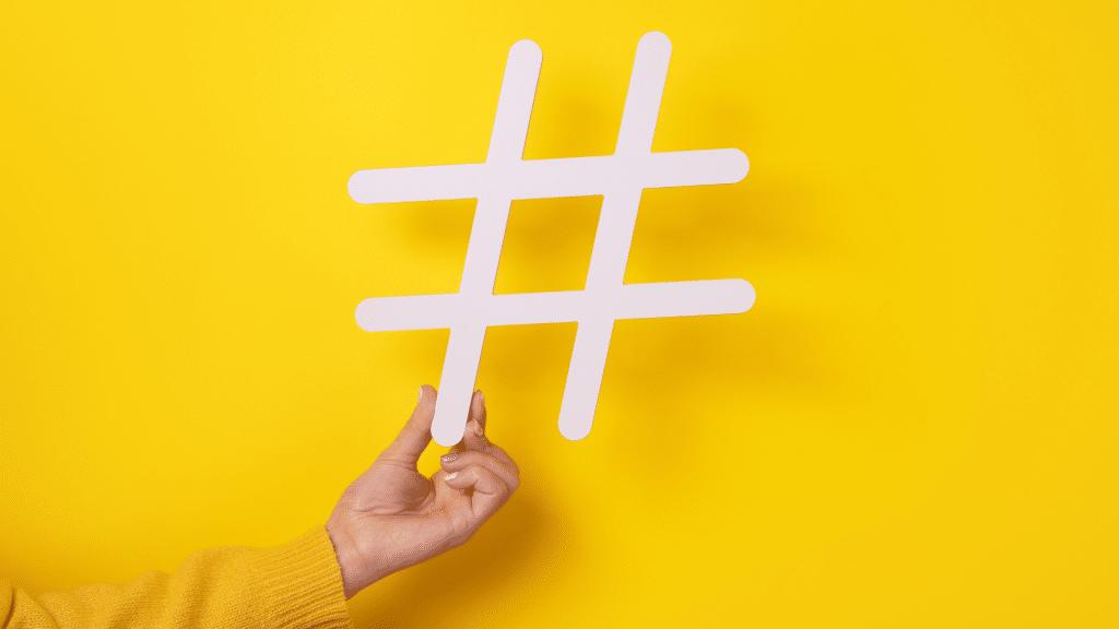 hand holding hashtag icon
