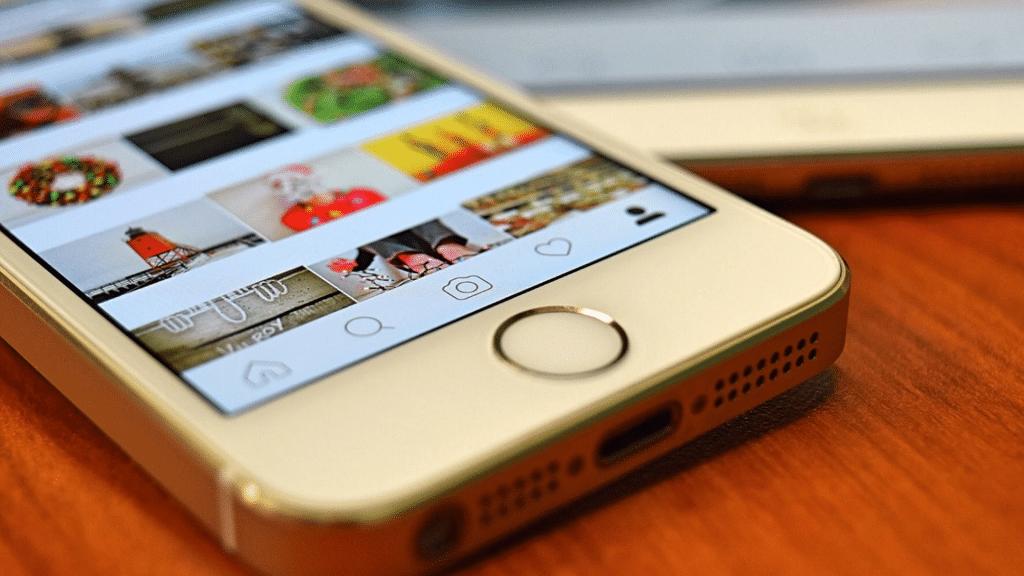 mobile phone on the desktop displaying instagram