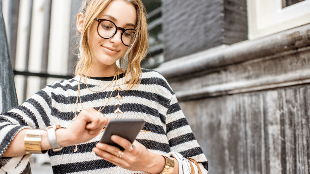 Woman scrolling Instagram on mobile phone